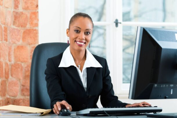 smiling business woman at computer