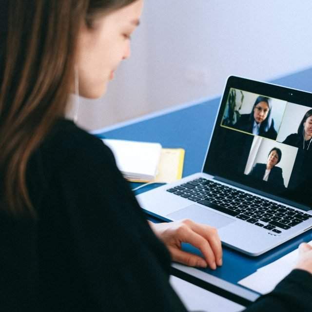 Woman looking at video conf call screen