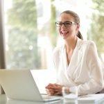 Confident business woman at laptop